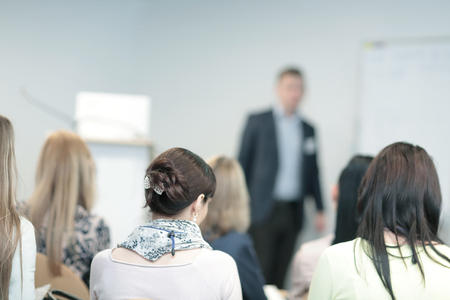 background image of a businessman speaking at a business seminar. Stock Photo
