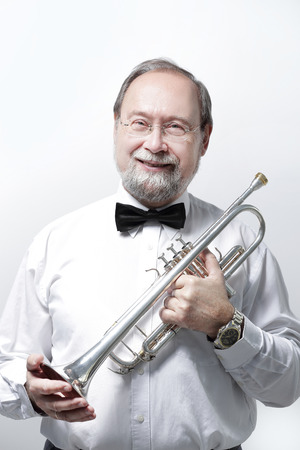 portrait.smiling adult man musician with a trumpet