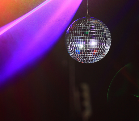 hand DJ holds disco ball. photo with copy space