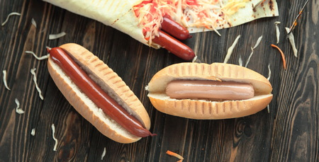 preparation of hot dogs with sausage.photo on a wooden background
