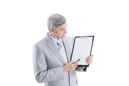 Mature businessman pointing at blank sheet.isolated on a white