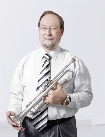 portrait.experienced teacher of music with a trumpet