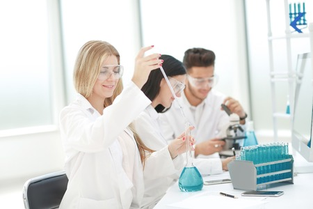 group of scientists conduct research in the laboratory