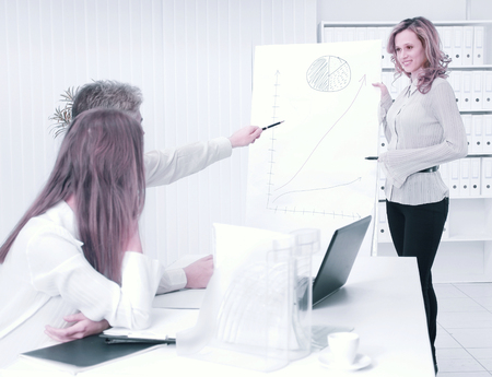 business woman conducts a presentation of a new project