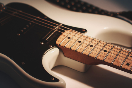 closeup. black guitar on a white background. photo with copy space Stock Photo