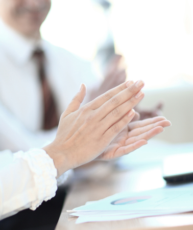 closeup. professional business team applauding the speaker