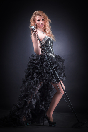 young female singer performing a musical composition Stock Photo