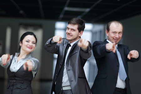 Successful business team pointing at you Фото со стока