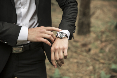close-up of a businessman looking at wrist watch
