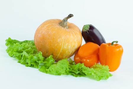 pumpkin,bell pepper,eggplant on lettuce leaves .isolated on white. 免版税图像