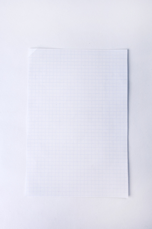 close up.a sheet of notebook and paper clip .photo with copy space.background. Фото со стока