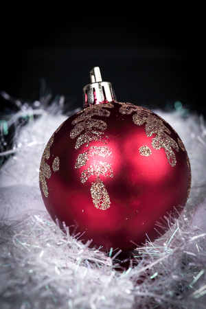beautiful red Christmas ball on a black background. Stock Photo