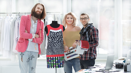 creative group of designers standing in a modern Studio.photo with copy space Stock fotó