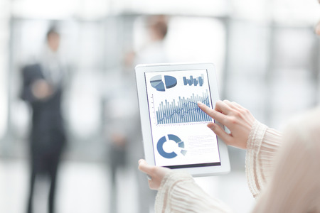 business woman points her finger at the screen of a digital tablet. photo with copy space