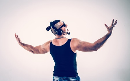 back view - emotional bodybuilder with headphones and sunglasses Banque d'images