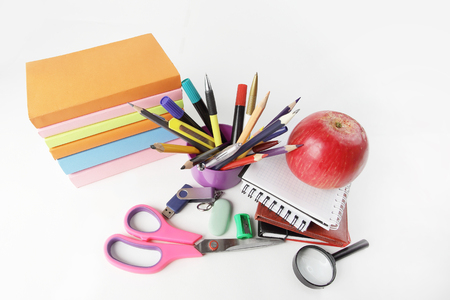 stack of books and colorful school supplies on white background.photo with copy space. Imagens