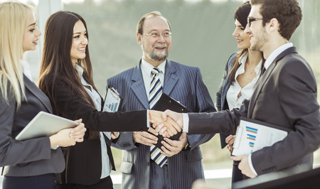 handshake financial partners, and attorneys of the company on the background of the office