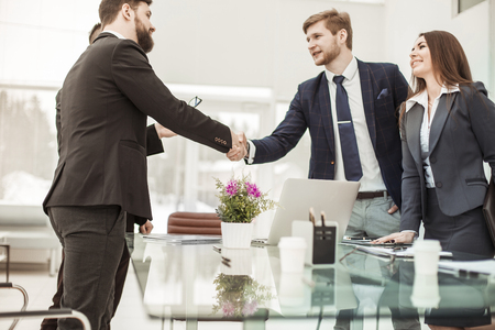 handshake business partners before discussing a new contract