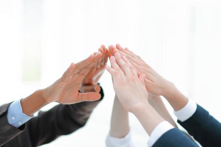 closeup.business team giving each other a high five. Standard-Bild
