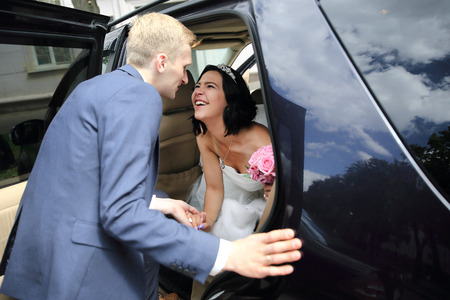 couple talking near wedding limo.holidays and events