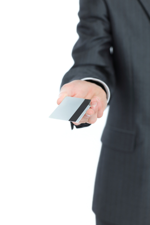 successful businessman holding out a blank business card.