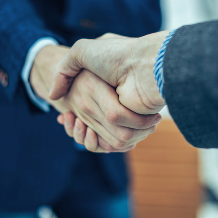 concept of partnership in business: a handshake of business part
