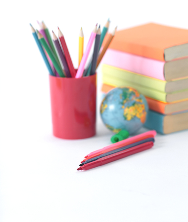 globe, books and pencils on white background .photo with copy space