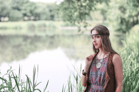 beautiful hippie girl on the background of a forest lake Stock Photo