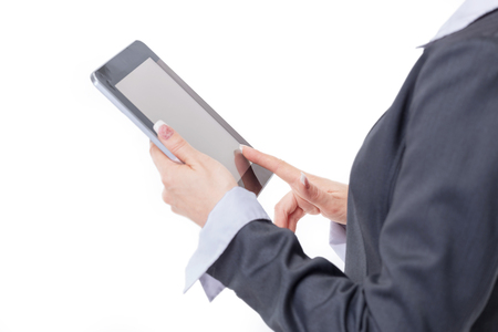 close up. modern business woman uses digital tablet.isolated on white background