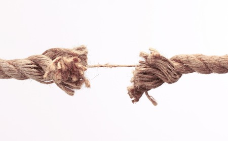 old frayed rope .isolated on a white background. photo with copy space
