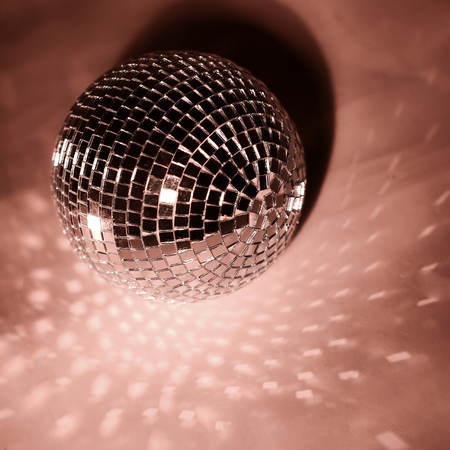 beautiful disco ball on yellow background isolated.photo with copy space Banco de Imagens