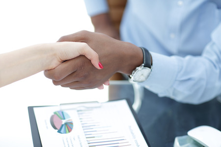 closeup.confident handshake between business people in the office. the concept of partnership
