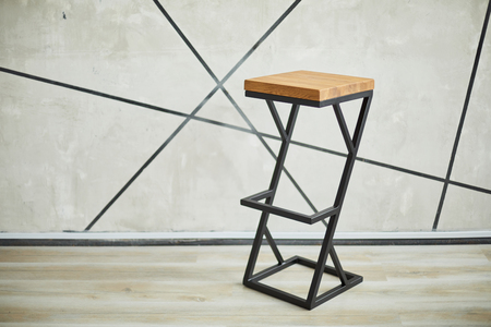 bar stool made of wood and metal. photo with copy space