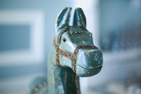 closeup.wooden horse on the background of a child's room.photo with copy space
