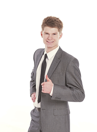 handsome businessman showing thumb up.isolated on a white