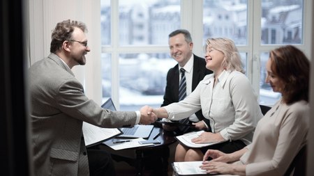 handshake financial partners prior to discussion of the transaction Stock Photo
