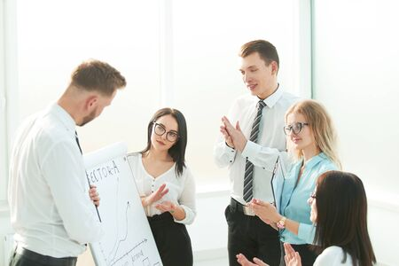 group of businesspeople clapping hands during meeting presentation Stock Photo