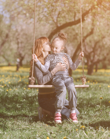 Mom and her little daughter spend their free time together Stock Photo