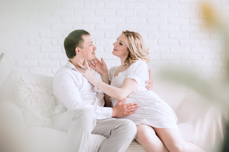 Beautiful young married couple looking at each other Stock Photo