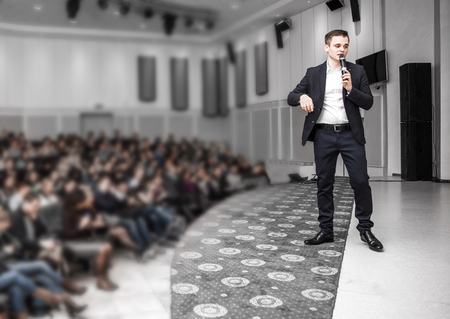Speaker speaks at a business conference in front of entrepreneurs and journalists