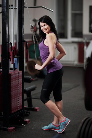 Portrait of smiling young woman in fitness club Stock Photo