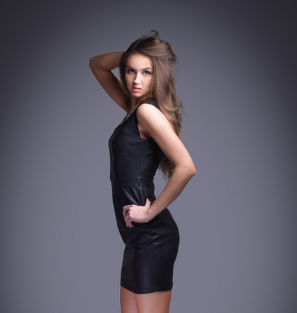 Confident young woman in fashionable dress