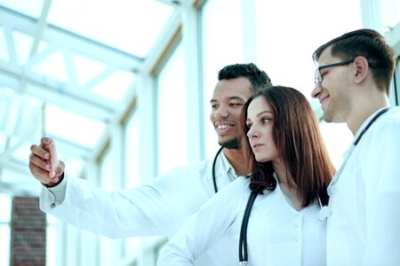 group of doctors interns taking selfies in the lobby of the hospital Stock Photo