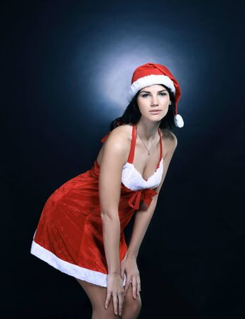 stylish young woman in costume of Santa Claus