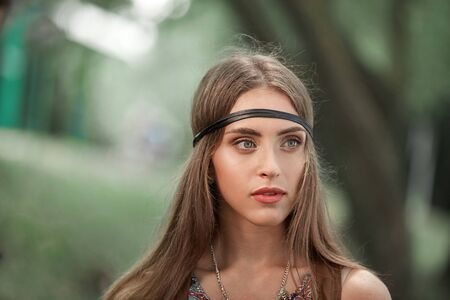 pensive young women hippie in the background of green foliage Archivio Fotografico