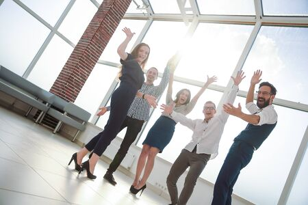 Cheering business team standing in the office