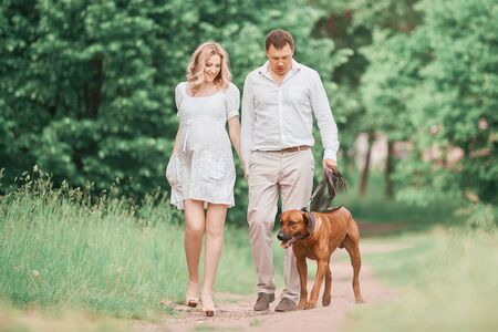 Happy young family on a walk in the city Park .