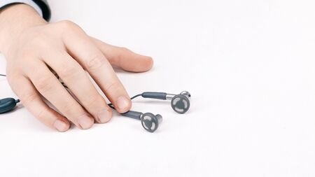 close-up of the earphone in the hands of men