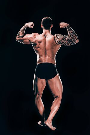 rear view. male bodybuilder showing his beautiful body