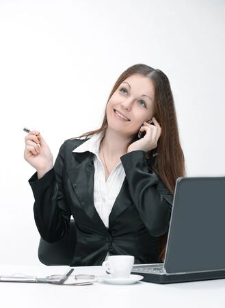 female assistant talking on cell sitting at her Desk